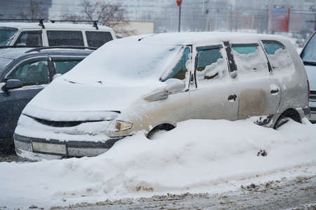 City extreme snowfall. Car covered with snow Stock Photo