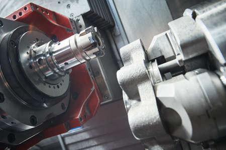 cnc machine at work. cutting tool processing steel metal detail on turning cnc lathe machine in workshop