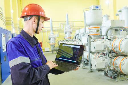industrial technicians works at power energy supply factory