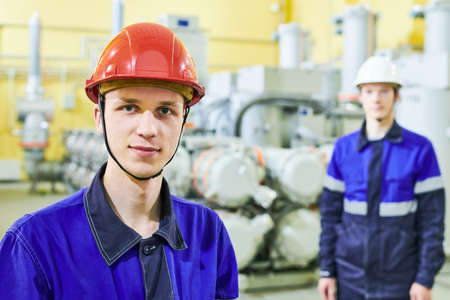 industrial worker portrait at power energy supply factory