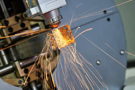 Laser cutting of metal pipe with sparks on tube laser machine