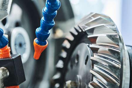 Spiral gear milling machine work. CNC grinding machine in metalwork industry