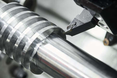 turning operation on cnc machine. metal cut work industry. Precision manufacturing and machining