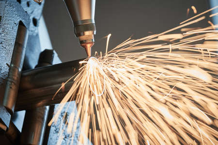 Fiber laser tube cutting machine. metal pipe cutting with sparks Standard-Bild