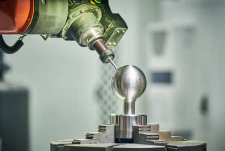 five axis cnc milling machine processing spherical detail. modern metal cutting industry