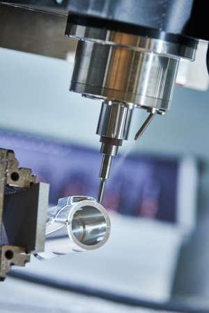 Precision machining metal detail on CNC milling machine Standard-Bild
