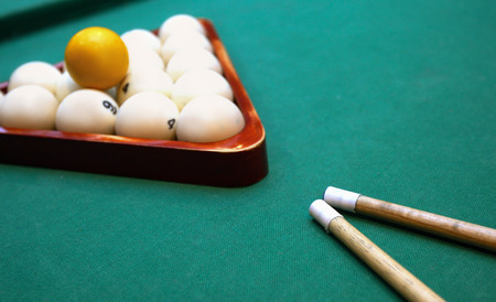 billiards cues: Billiards. Top view of billiard balls and cues on green table