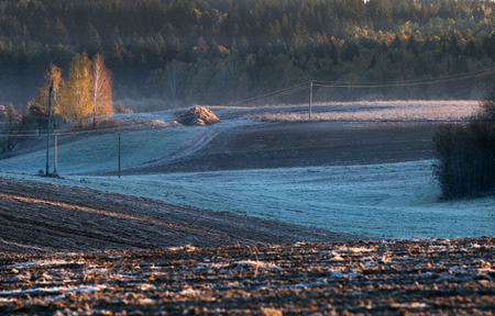 plowed field: Melting snow on the plowed field isolated Stock Photo