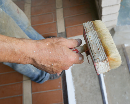 homeownership: Hand with paintbrush painting , isolated