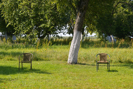 two chairs: Two  chairs in the park Stock Photo