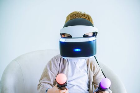 The boy wearing virtual reality glasses