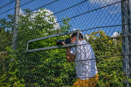 Nurburg, Germany - August 20, 2015. Road to Nurburgring. Paparazzi filming new cars on the Nurburgring