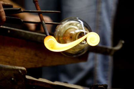 Neman plant, glass blowers, Berezovka. Crystal production, glass museum, vase, Brezhnev Myagkov Glassblower forming the beautiful piece of glass. The glass master burns and blows out the work of art. Stock fotó