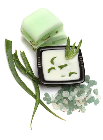 Aloe vera leaves, handmade soap and bath salt isolated on white Stock Photo