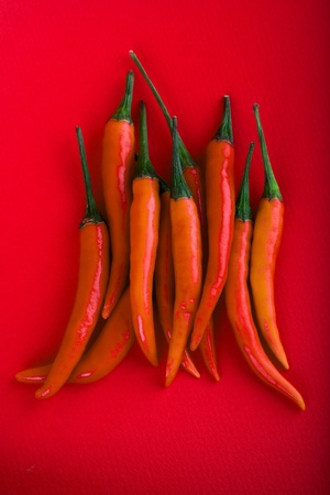 red hot chili peppers on pink background Stock Photo