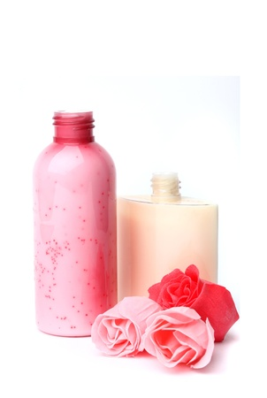 Spa composition. Scrub and moisturizer and roses 스톡 사진
