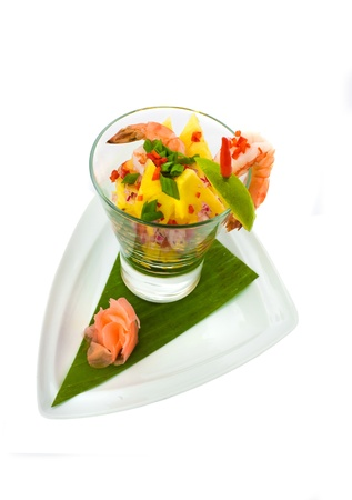 Fresh exotic seafood coctail salad isolated on white Stock Photo