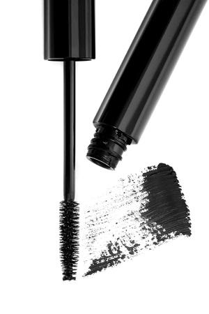 Black mascara stroke and brush isolated on white