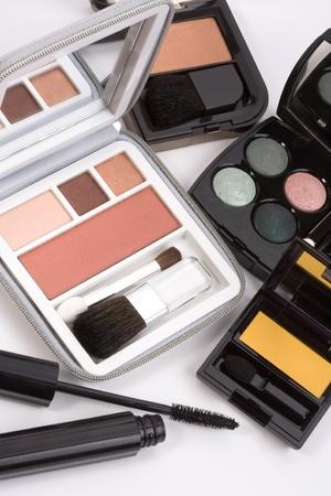 Macro shot of blush and eyeshadow palettes and mascara