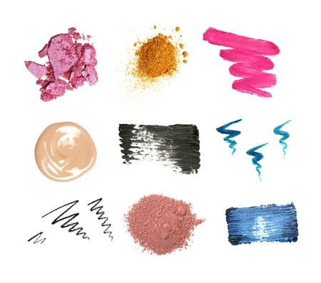 mascara: Decorative cosmetic samples isolated on white. Lipstick, lip gloss, eyeshadow, pencil and mascara strokes, powder, foundation spilling.