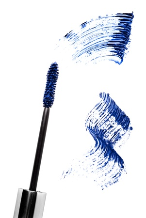 Blue mascara stroke and brush  isolated on white. Cosmetic product sample. Stock Photo - 9636444