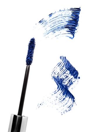 Blue mascara stroke and brush  isolated on white. Cosmetic product sample.