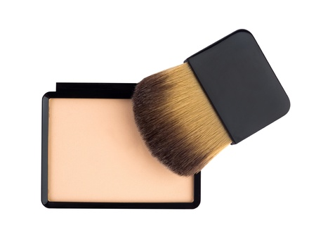Beige compact cosmetic powder and brush isolated on white Stock Photo