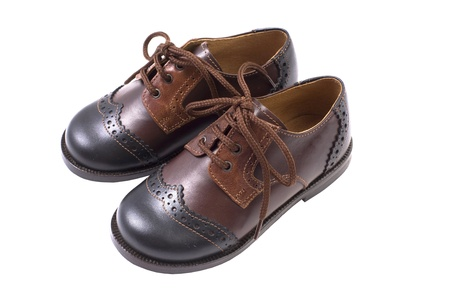Kids autumn or spring luxury leather brown shoes isolated on white