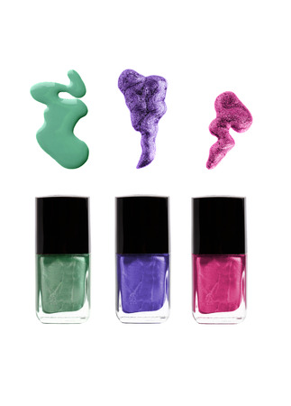 Nail polish bottles with spills  green, violet, purple or pink colors Banque d'images