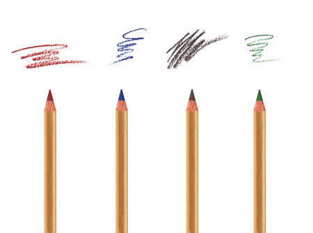 Four cosmetic pencils isolated on white with sample strokes  Eye, brow and lip liner