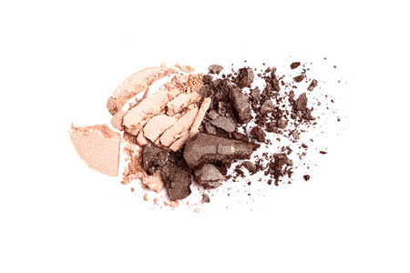 crushed by: Beige and brown crushed eyeshadow on white background