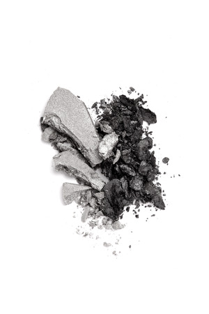 eyeshadow: Graphite and gray duo eyeshadow crushed isolated on white background Stock Photo