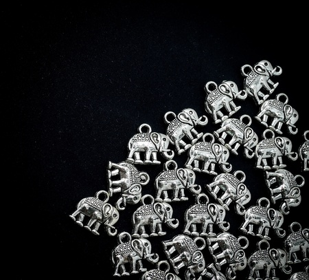 Silver material in elephant shape on black background Stock Photo