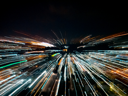 Light lines with long exposure, speed motion abstract background in the dark night, blast zoom effect, zoom burst of light in the city Reklamní fotografie