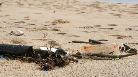 Environmental pollution. Ecological problem. Garbages, plastic, and wastes on the sandy beach of tropical sea.  Banque d'images