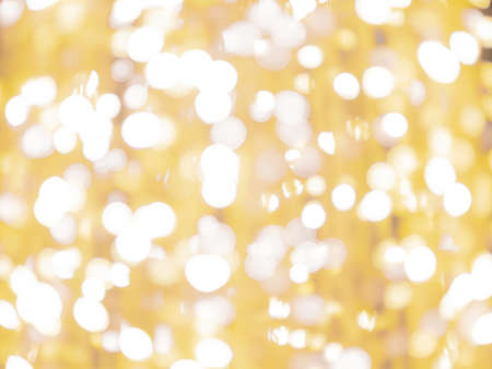 blurred bokeh light defocused background and textured for Christmas , New Year holidays party and celebration background, golden colour