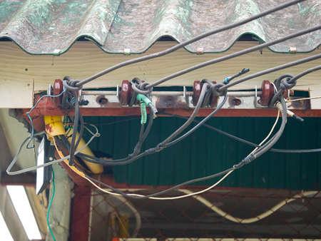 high voltage power lines under roof building Reklamní fotografie