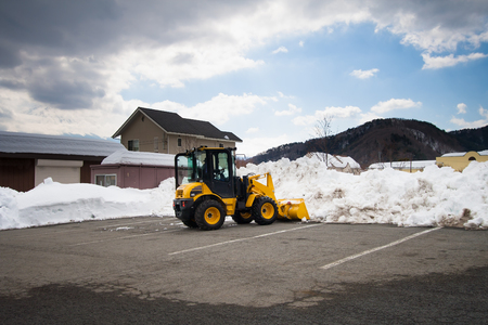 snow clearing: Truck is clearing snow from the park