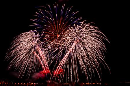 hanabi: Fireworks over the city celebrate in happy festival. Stock Photo