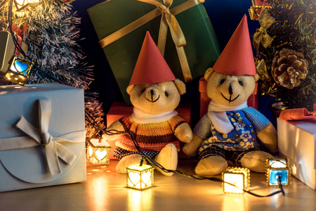 christmas frog: Ornament and teddy bear, Christmas decorate at Merry Christmas night light. Christmas tree and other decoration with Lovely gift and ribbon .