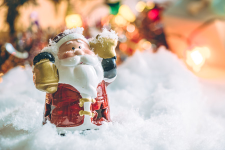 hopefulness: Santa claus hold the bell and star and light bulb stand in silent night, light up the hopefulness and happiness in Merry christmas and new year night. Stock Photo