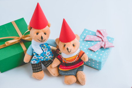 christmas frog: a couple lovely teddy bear and Ornament, Christmas decorate at Merry Christmas and happy new year night light. Christmas tree and other decoration with Lovely gift and ribbon
