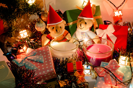 christmas frog: A couple teddy bears, White and violet christmas candle, and  Ornament decorate Merry Christmas and happy new year Stock Photo