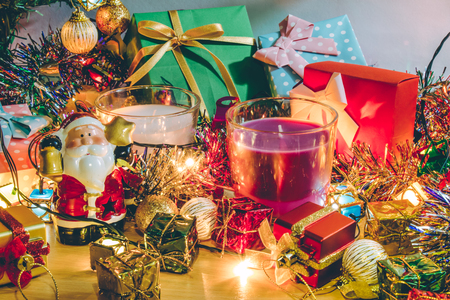 christmas frog: Santa claus hold bell and christmas candle, couple teddy bears and Ornament decorate Merry Christmas and happy new year Stock Photo