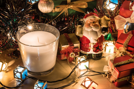 christmas frog: Santa claus hold bell, white and violet christmas candle, Ornament decorate Merry Christmas and happy new year Stock Photo