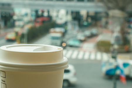 coffee hour: Slow life, Coffee time in rush hour of Big City with blur of people across pedestrian at Shibuya Junction, Tokyo, Japan