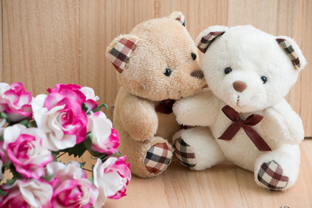 amorousness: Embrace Bears in love sit near bouquet rose. Love is in the air. Stock Photo