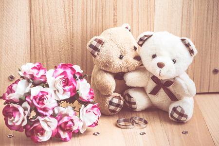 amorousness: Embrace Couple Bear in love, sit near bouquet rose and engage ring, Style Vintage background