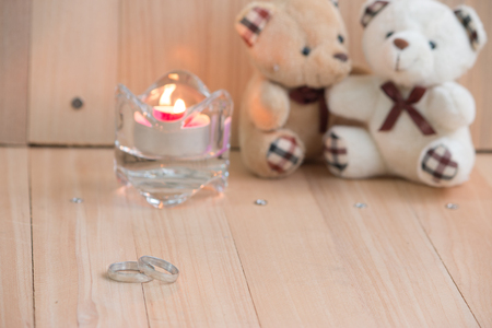 amorousness: Embrace Bears in love, sit near Engagement ring and Candlestick