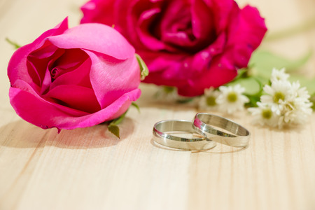 bunch of hearts: Engage Ring put near Red roses on wood background